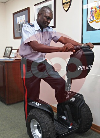 Station Sergeant Roland Cobbler tests out one of the new Segways.